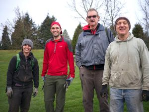 [Click to enlarge] Mary Verrilli (L) of Portland City Nature West with neighborhood volunteers at the Gabriel Park invasive removal work party 1/24/15.